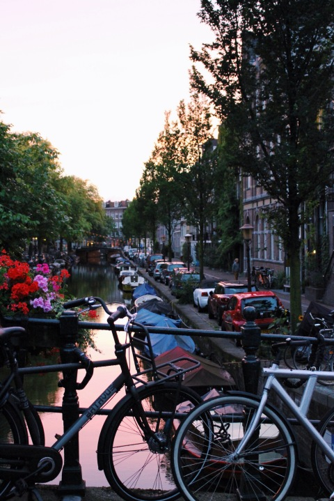 Canal Amsterdam travel bike